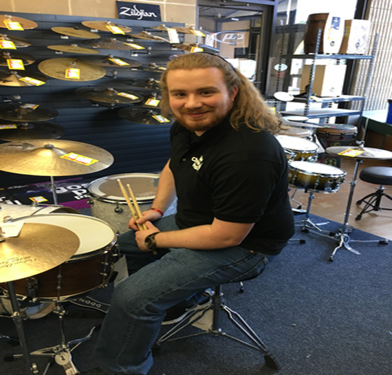 Click to view a larger image of Matt amongst our large selection of percussion instruments!